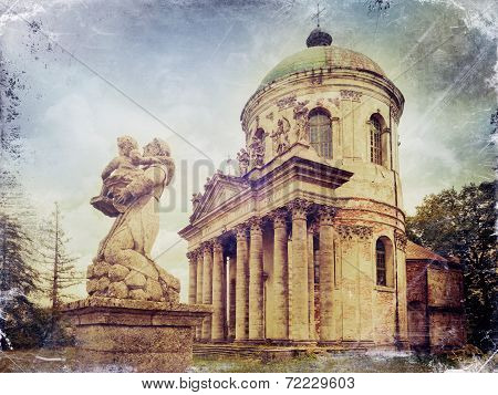 Statues And Roman Catholic Church Of The Exaltation Of The Holy And St. Joseph. Pidhirtsi Castle