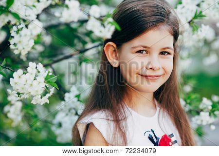 little girl at apple tree flowers
