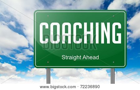 Coaching on Green Highway Signpost.