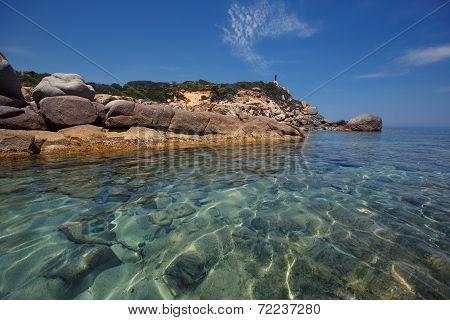 Rocks at Cala Sinzias beach and sea view, Sardinia