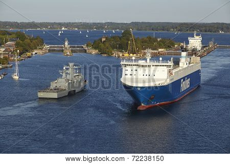 Kiel - Ro-ro Cargo Ship And Naval Vessel At Kiel Canal