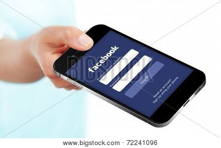 Gdansk -  Poland, September 16, 2014. Hand Holding Smartphone With Facebook Login Page. Facebook Is