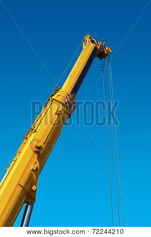 Heavy Hydraulic Crane On Blue Sky