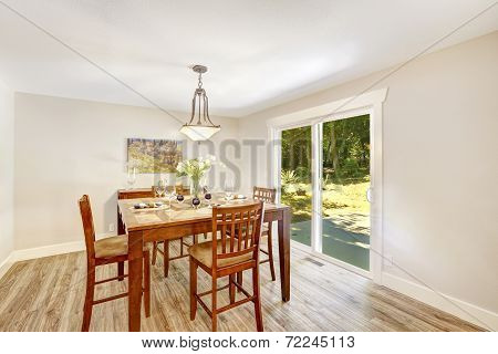 Ivory Dining Room With Walkout Patio