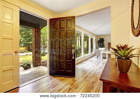 Entrance Hallway With Open Door