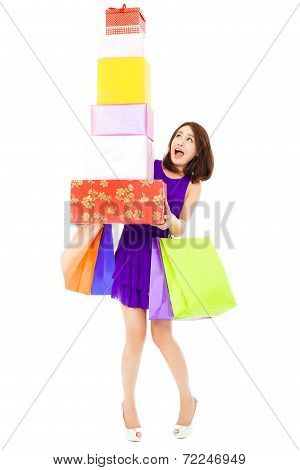 Young Woman shoked and Holding Shopping Bag And Gift Boxes