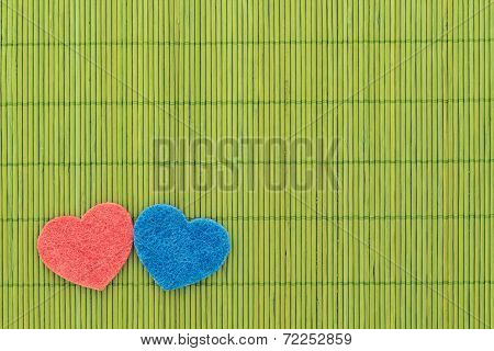Blue And Red Hearts Against Bamboo Sticks