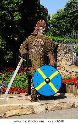 Floral knight with sword and shield.