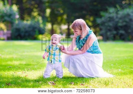Woman And Baby In A Park