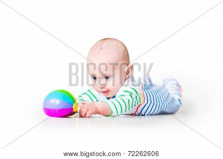 Happy Laughing Funny Baby Boy Wearing A Colorful Shirt Learning To Crawl Playing On His Tummy