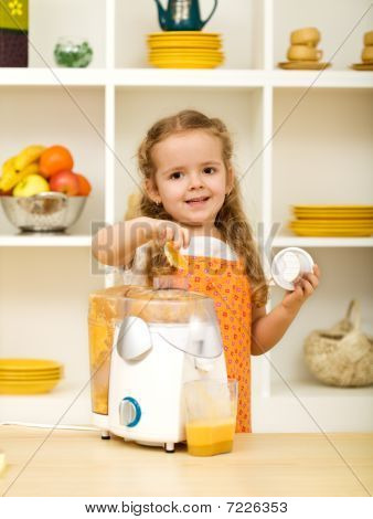 Little Girl Making Fresh Fruit Juice