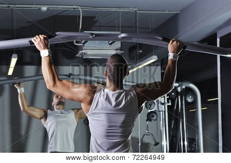 Handsome Muscular Male Model With Perfect Body Doing Pull Ups