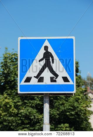 Pedestrian Sign With Blue Sky And Tree Background