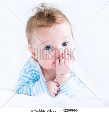 Sweet Baby In A Blue Shirt Sucking On Its Finger
