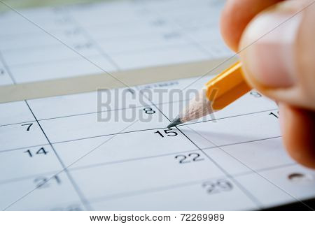 Person Marking The Date Of The 15Th