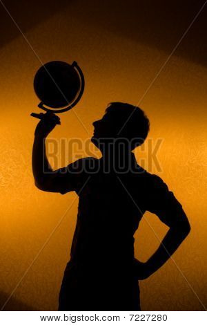 Back Light - Silhouette Of Man Holding Globe