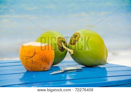 coconuts on a table by the beach in livingston guatemala