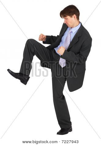 Businessman Kicks Down On White Background