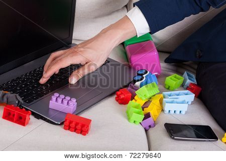 Businessman Among Child's Toys