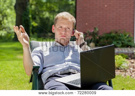 Businessman Working In A Garden