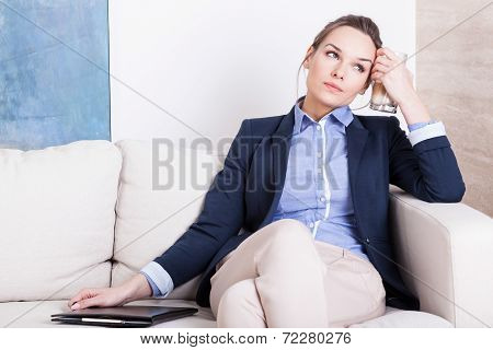 Young Businesswoman Tired On Couch