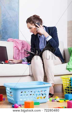Woman Doing Housework And Calling Mobile Phone The Same Time