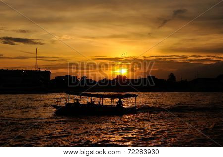 Silhouette Of The Boat At Sunset At Chao Praya River. Bangkok, Thailand.