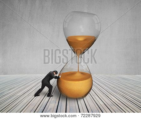 Businessman Pushing Inclined Sandglass