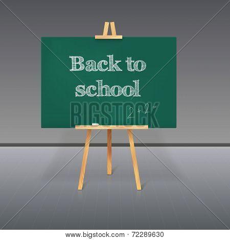 Green school board with chalk on a tripod