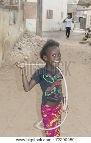 Unidentified girl playing with a jump rope