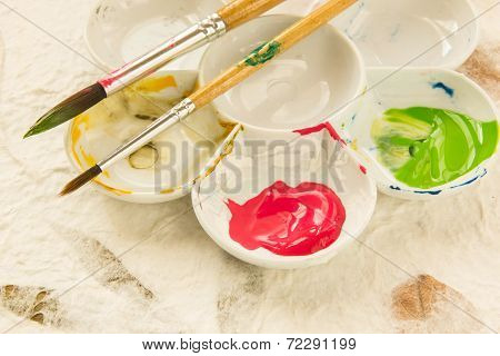 Paintbrush And Ink In The Palette