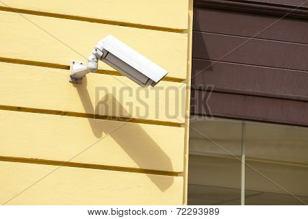 Security camera on a wall.