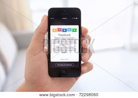 Iphone 5 In Male Hand With Passbook On The Screen