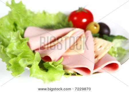 Sliced Food Arrangement With Sausage, Cherry Tomatoes, Cheese And Greenery