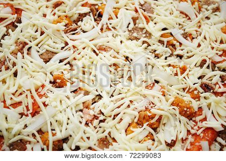 Uncooked Cheesy, Meaty Pizza Pie Covered With Cheese