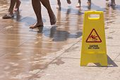 picture of slip hazard  - Wet floor sign-Warning signs on the slippery floor ** Note: Visible grain at 100%, best at smaller sizes - JPG