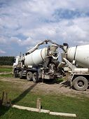 stock photo of concrete pouring  - Pouring concrete mixer with pump without pump mixer at construction site - JPG