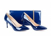 stock photo of clutch  - Beautiful blue shoes with clutches on white isolated background - JPG