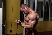 picture of light weight  - Young Bodybuilder Doing Heavy Weight Exercise For Biceps - JPG