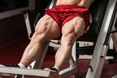 stock photo of light weight  - Male Bodybuilder Doing Heavy Weight Exercise For Legs