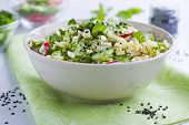 stock photo of tabouleh  - Bowl full of fresh salad with millet - JPG