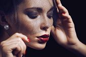image of grieving  - beauty brunette woman under black veil with red manicure close up - JPG