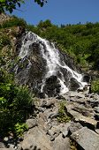 stock photo of splayed  - Horsetail falls in Whittier Alaska splays out like a fan - JPG