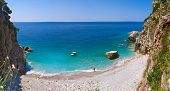 image of yugoslavia  - The cozy beach is hidden among the rocks between Petrovac and Rezevici the best way to get here is to rent a boat and enjoy the silence and privacy Montenegro - JPG