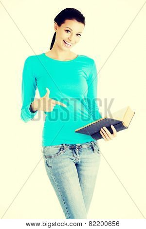 Young casual woman student with book.