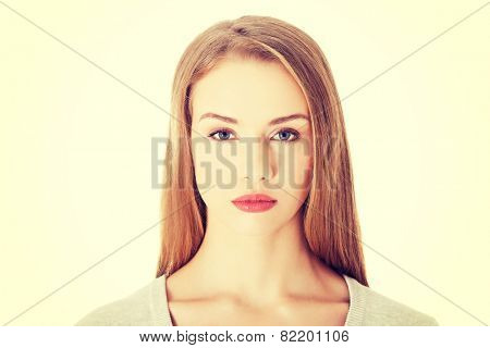 Beautiful casual woman with serious face.