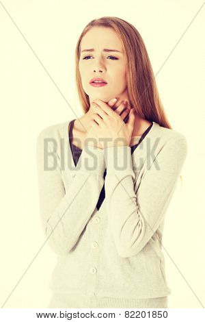 Beautiful casual woman is having sore throat.