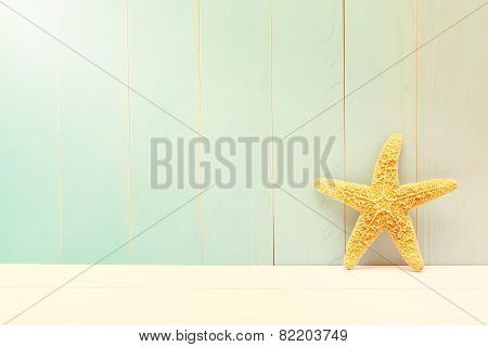 Starfish On A Teal Wooden Background