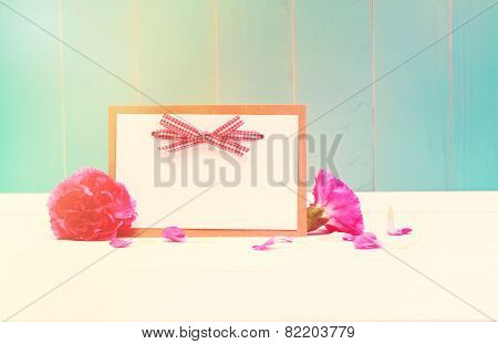 Card With Carnations On Teal Colored Wood