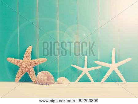 Starfish And Sea Shells On A Teal Wooden Background